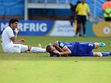 Uruguay's forward Luis Suarez reacts past Italy's defender Giorgio Chiellini during a Group D football match between Italy and Uruguay at the Dunas Arena in Natal during the 2014 FIFA World Cup on June 24, 2014