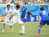 Uruguay's forward Luis Suarez and Italy's midfielder Claudio Marchisio vie during the Group D football match between Italy and Uruguay at the Dunas Arena in Natal during the 2014 FIFA World Cup on June 24, 2014