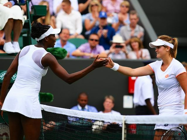 Venus Williams and Maria-Teresa Torro-Flor shake hands after their first-round Wimbledon encounter on June 23, 2014.