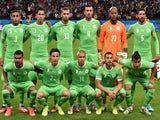 Algeria's players lineup prior to the game with Germany on June 30, 2014