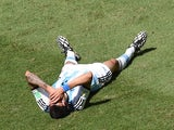 Argentina's midfielder Angel Di Maria lies on the ground during a quarter-final football match against Belgium on July 5, 2014