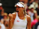 Angelique Kerber of Germany celebrates during her Ladies' Singles fourth round match against Maria Sharapova of Russia on day eight of the Wimbledon Lawn Tennis Championships at the All England Lawn Tennis and Croquet Club on July 1, 2014