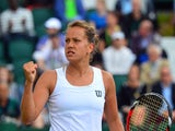 Czech Republic's Barbora Zahlavova Strycova reacts to winning a point against Denmark's Caroline Wozniacki during their women's singles fourth round match on day seven of the 2014 Wimbledon Championships at The All England Tennis Club in Wimbledon, southw
