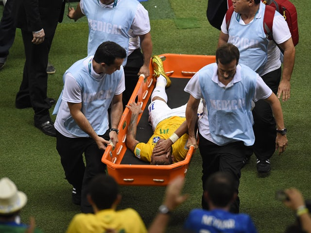 Brazil's forward Neymar is carried on a stretcher after he was injured following a tackle during the quarter-final football match between Brazil and Colombia at the Castelao Stadium in Fortaleza during the 2014 FIFA World Cup on July 4, 2014