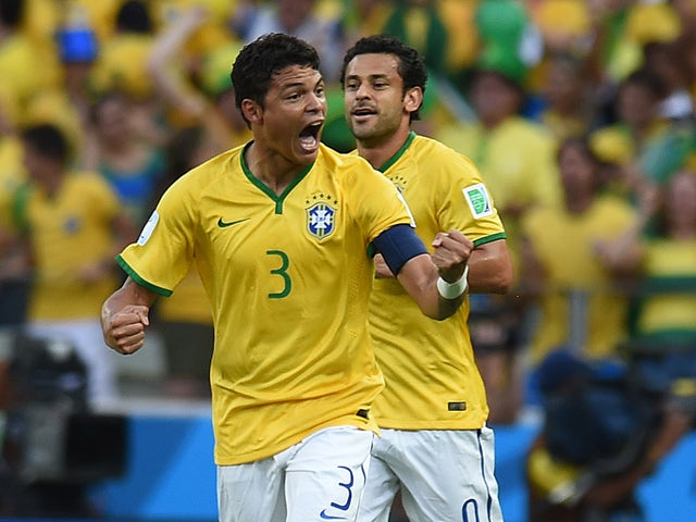 Brazil's defender and captain Thiago Silva celebrates scoring during the quarter-final football match between Brazil and Colombia at the Castelao Stadium in Fortaleza during the 2014 FIFA World Cup on July 4, 2014