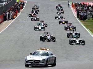 The safety car leads the field following a re-start during the British Formula One Grand Prix at Silverstone Circuit on July 6, 2014