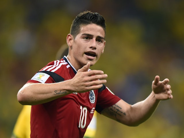 Colombia's midfielder James Rodriguez celebrates after scoring during the quarter-final football match between Brazil and Colombia at the Castelao Stadium in Fortaleza during the 2014 FIFA World Cup on July 4, 2014