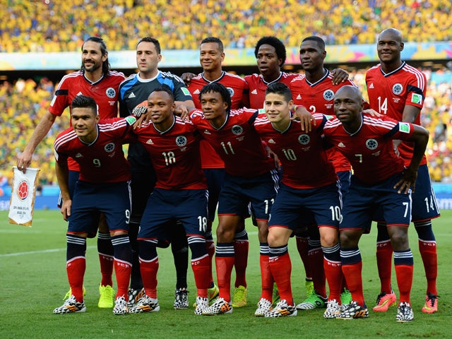 Colombia pose for a team photo prior to the 2014 FIFA World Cup Brazil Quarter Final match between Brazil and Colombia at Castelao on July 4, 2014