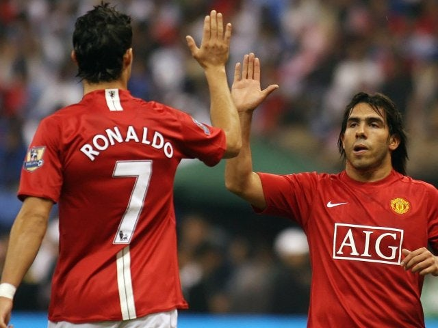 Cristiano Ronaldo and Carlos Tevez celebrate the latter's goal for Manchester United on January 21, 2008.