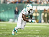 Dion Jordan #95 of the Miami Dolphins in action against the New York Jets during their game at MetLife Stadium on December 1, 2013