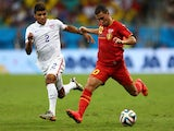 Eden Hazard of Belgium controls the ball as DeAndre Yedlin of the United States gives chase during the 2014 FIFA World Cup Brazil Round of 16 match on July 1, 2014