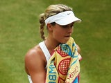Eugenie Bouchard of Canada stands dejected during the Ladies' Singles final match against Petra Kvitova on July 5, 2014