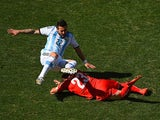 Ezequiel Lavezzi of Argentina is challenged during the World Cup round of 16 match against Switzerland in Sao Paulo on July 1, 2014