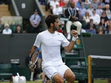 Spain's Feliciano Lopez winning a game against US player John Isner during his men's singles third round match on day seven of the 2014 Wimbledon Championships at The All England Tennis Club in Wimbledon, southwest London, on June 30, 2014