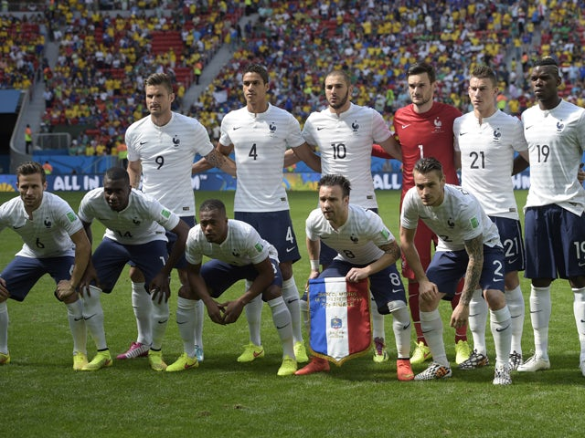 French players pose for a group picture before the round of 16 football match between France and Nigeria at the Mane Garrincha National Stadium in Brasilia during the 2014 FIFA World Cup on June 30, 2014