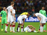 Shkodran Mustafi of Germany lies on the field as his teammates and referee Sandro Ricci look on during the 2014 FIFA World Cup Brazil Round of 16 match between Germany and Algeria at Estadio Beira-Rio on June 30, 2014