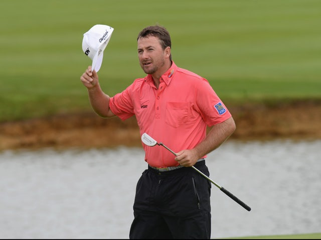 Graeme McDowell of Northern Ireland acknowledges the crowd after finishing his round on the 18th green during the Alstom Open de France - Day Four at Le Golf National on July 6, 2014