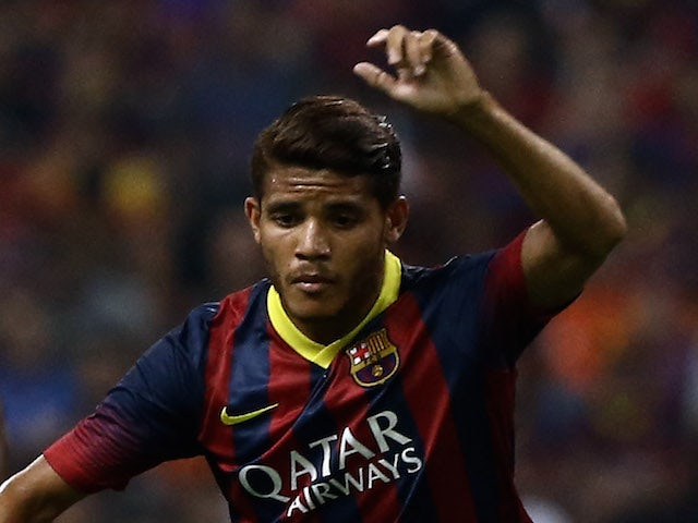 Jonathan dos Santos of Barcelona FC dribbles during the friendly match between FC Barcelona and Malaysia at Shah Alam Stadium on August 10, 2013