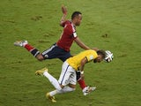 Colombia's defender Juan Camilo Zuniga (L) fouls Brazil's forward Neymar during the quarter-final football match on July 4, 2014