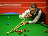 Judd Trump plays a shot in his quarter final match against Neil Robertson at the Crucible Theatre on April 30, 2014