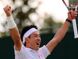 Japan's Kei Nishikori celebrates winning his men's singles third round match against Italy's Simon Bolelli on day seven of the 2014 Wimbledon Championships at The All England Tennis Club in Wimbledon, southwest London, on June 30, 2014