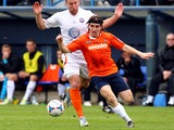 Luke Rooney of Luton Town goes past Matt Paine of Braintree Town during the Skrill Conference Premier match between Luton Town and Braintree Town at Kenilworth Road on April 12, 2014