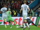 Germany's goalkeeper Manuel Neuer (R) and Algeria's forward Sofiane Feghouli (2L) vie for the ball during a Round of 16 football match on June 30, 2014