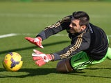 AC Milan's goalkeeper Marco Amelia warms up prior the Italian Serie A football match between Cagliari and AC Milan on January 26, 2014