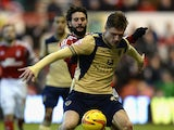 Marius Zaliukas of Leeds United holds off a challenge from Djamal Abdoun of Nottingham Forest during the Sky Bet Championship match between Nottingham Forest and Leeds United at City Ground on December 29, 2013
