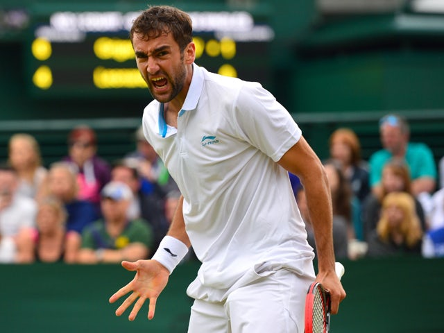 Croatia's Marin Cilic celebrates on defeating France's Jeremy Chardy during their men's singles fourth round match on day seven of the 2014 Wimbledon Championships at The All England Tennis Club in Wimbledon, southwest London, on June 30, 2014