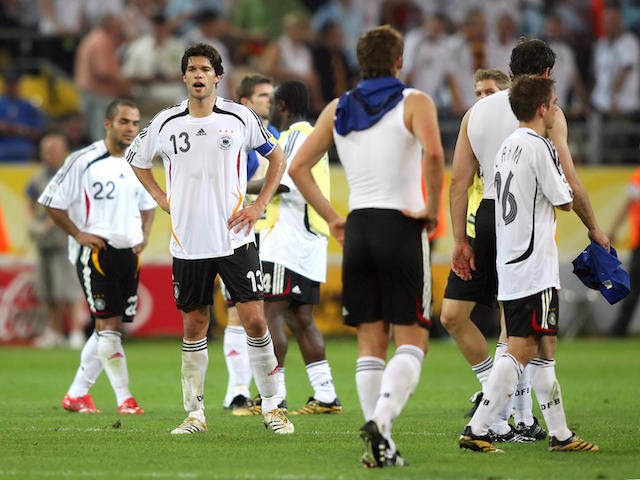 German midfielder Michael Ballack (2ndL) looks dejected at the end of the World Cup 2006 semi final football game Germany vs. Italy, 04 July 2006