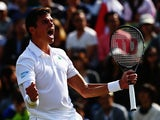 Milos Raonic of Canada celebrates winning his Gentlemen's Singles fourth round match against Kei Nishikori of Japan on day eight of the Wimbledon Lawn Tennis Championships at the All England Lawn Tennis and Croquet Club on July 1, 2014