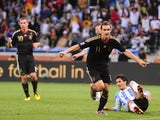 Germany's striker Miroslav Klose celebrates after scoring the team's fourth goal against Argentina during the 2010 World Cup quarterfinal football match on July 3, 2010