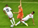 Netherlands' forward Arjen Robben vies with Costa Rica's defender Junior Diaz (L) during a quarter-final football match between Netherlands and Costa Rica at the Fonte Nova Arena in Salvador during the 2014 FIFA World Cup on July 5, 2014