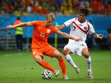Dirk Kuyt of the Netherlands is challenged by Christian Bolanos of Costa Rica during the 2014 FIFA World Cup Brazil Quarter Final match between the Netherlands and Costa Rica at Arena Fonte Nova on July 5, 2014