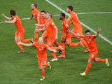 Netherlands players celebrate after defeating Costa Rica in a penalty shootout during the 2014 FIFA World Cup Brazil Quarter Final match between the Netherlands and Costa Rica at Arena Fonte Nova on July 5, 2014