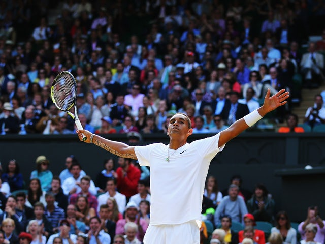 Nick Kyrgios of Australia celebrates during his Gentlemen's Singles fourth round match against Rafael Nadal of Spain on day eight of the Wimbledon Lawn Tennis Championships at the All England Lawn Tennis and Croquet Club on July 1, 2014