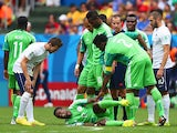 Ogenyi Onazi of Nigeria reacts after a challenge by Blaise Matuidi of France as referee Mark Geiger looks on during the 2014 FIFA World Cup Brazil Round of 16 match between France and Nigeria at Estadio Nacional on June 30, 2014