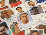 Panini World Cup stickers are displayed, including one of England star Wayne Rooney (C), on May 28, 2014