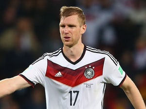 Mertesacker collects Germany gong