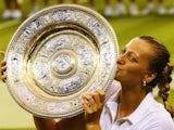 Czech tennis player Petra Kvitova lifts the Venus Rosewater Dish after winning Wimbledon on July 5, 2014