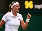 Czech Republic's Petra Kvitova reacts after winning a game against China's Peng Shuai during their women's singles fourth round match on day seven of the 2014 Wimbledon Championships at The All England Tennis Club in Wimbledon, southwest London, on June 3