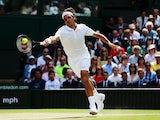 Roger Federer of Switzerland stretches to make a return during the Gentlemen's Singles Final match against Novak Djokovic on July 6, 2014