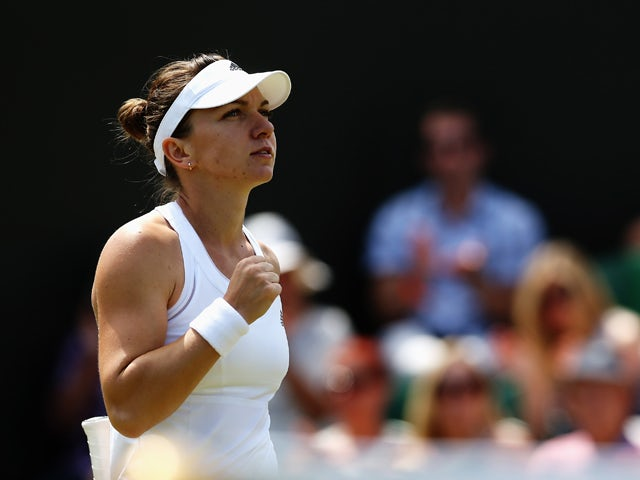Simona Halep of Romania celebrates after winning her Ladies' Singles fourth round match against Zarina Diyas of Kazakhstan on day eight of the Wimbledon Lawn Tennis Championships at the All England Lawn Tennis and Croquet Club on July 1, 2014