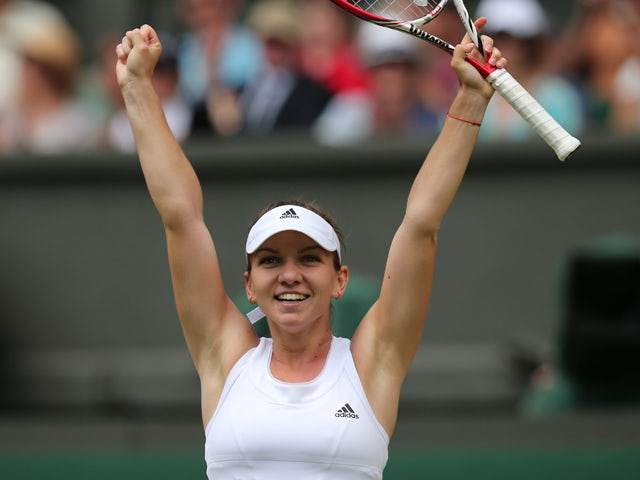 Romania's Simona Halep celebrates winning her women's singles quarter-final match against Germany's Sabine Lisicki on day nine of the 2014 Wimbledon Championships at The All England Tennis Club in Wimbledon, southwest London, on July 2, 2014