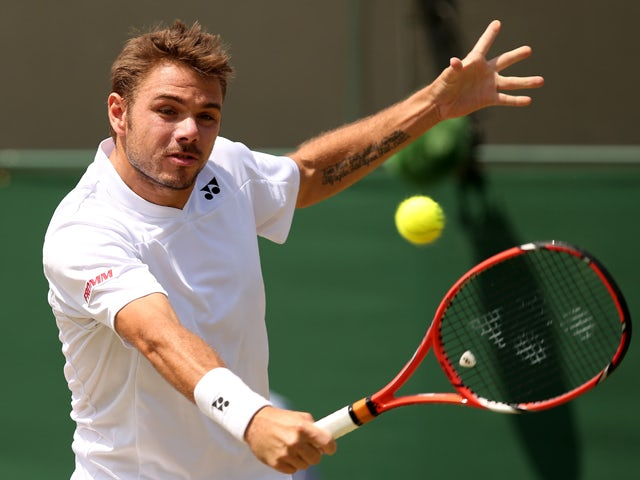 Switzerland's Stanislas Wawrinka returns to Spain's Feliciano Lopez during their men's singles fourth round match on day eight of the 2014 Wimbledon Championships at The All England Tennis Club in Wimbledon, southwest London, on July 1, 2014