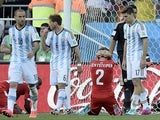 Switzerland's defender Stephan Lichtsteiner (C) reacts after Switzerland missed a chance at the end of a Round of 16 football match against Argentina on July 1, 2014