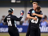 Matthew Dunn of Surrey celebrates with Jason Roy and Gary Wilson after taking the wicket of Essex's Mark Pettini during the Natwest T20 Blast match between Essex Eagles and Surrey at Chelmsford County Cricket Ground on July 04, 2014