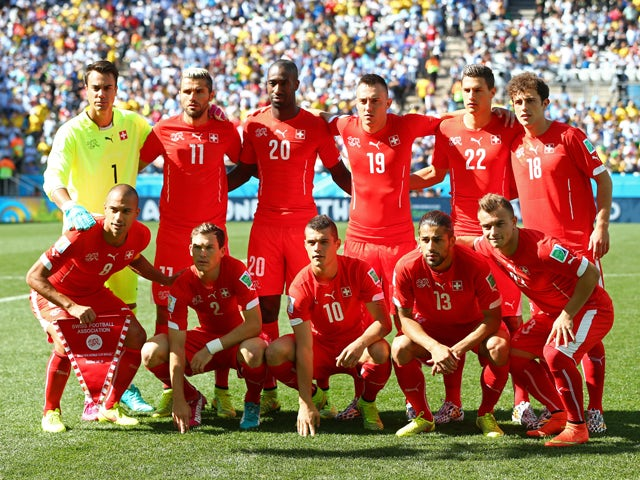 Switzerland players pose for a team photo prior to the 2014 FIFA World Cup Brazil Round of 16 match between Argentina and Switzerland at Arena de Sao Paulo on July 1, 2014