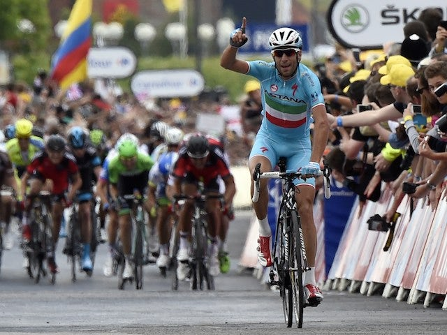 Italy's Vincenzo Nibali celebrates as he crosses the finish line at the end of the 201 km second stage of the 101th edition of the Tour de France cycling race on July 6, 2014 between York and Sheffield